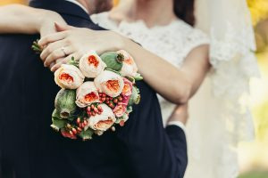 Bride Hug Groom With Wedding Bouquet